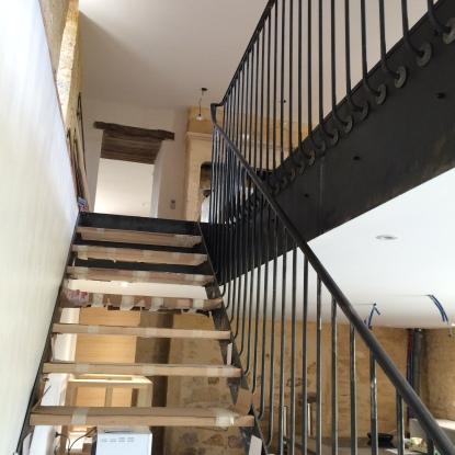 L'escalier descendant à la cuisine
